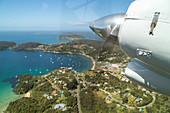 view from window, flight above Oban on Halfmoon Bay, Stewart Island, Rakiura, New Zealand