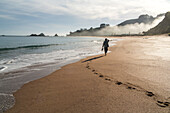 morning sea mist, footprints in sand on beach, person, pristine beach, Tauranga Bay, Northland, North Island, New Zealand