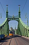 Tram on Szabadsag Hid (Liberty Bridge), Budapest, Hungary
