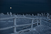 Full moon behind a frozen fence, Winter landscape, Schierke, Brocken, Harz national park, Saxony, Germany