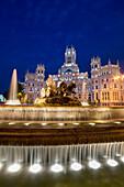 Fountain and Plaza de Cibeles Palace (Palacio de Comunicaciones) at dusk, Plaza de Cibeles, Madrid, Spain, Europe