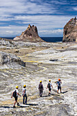 Tourists exploring White Island Volcano, an active volcano in the Bay of Plenty, North Island, New Zealand, Pacific