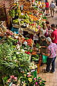 Shoppers at stalls with fresh produce, Mercado Dos Lavradores (Farmers' Market), Funchal, Madeira, Atlantic, Portugal, Europe