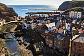Winding alleys, fishing boats and sea, elevated view of village in summer, Staithes, North Yorkshire Moors National Park, Yorkshire, England, United Kingdom, Europe