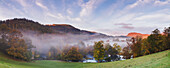 Panorama overlooking Horseshoe Falls with mist lying above the River Dee on an autumn morning, Denbighshire, Wales, United Kingdom, Europe