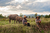 Farmers take a break from working the fields near Yuanmou, Yunnan Province, China, Asia