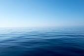 Horizon over water, blue sky and calm water. Mediterranean Sea, near Balearic Islands