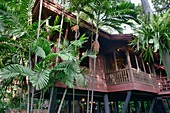 Teak architecture at the Jim Thompson House and museum in Bangkok, Thailand.
