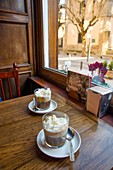 Two Irish coffees in a traditional cafe. San Lorenzo del Escorial, Madrid province, Spain.