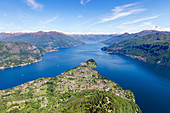 Aerial view of the village of Bellagio frames by the blue water of Lake Como on a sunny spring day Lombardy Italy Europe.