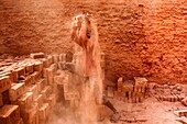 A labourer working in a brickfield covered with dust in Dhaka, Bangladesh, January 18, 2016. In this brickfield burning coal causes tremendous production of Carbon-Di-Oxide (CO2) gas, which is primarily responsible for climate change. Beside this the work
