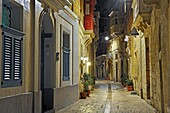 Narrow street in the center of Birgu (Vittoriosa), Three Cities, Malta, Southern Europe.