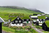The village on the island Mykines, part of the Faroe Islands in the North Atlantic. Europe, Northern Europe, Denmark, Faroe Islands.