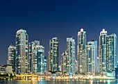 Night view of many high-rise luxury apartment towers in Downtown Dubai United Arab Emirates.