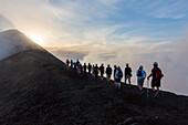 Tourists climbing the summit of Stromboli Volcano at sunset, Stromboli Island, Aeolian Islands, Lipari Islands, Tyrrhenian Sea, Mediterranean Sea, Italy, Europe