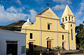 San Vincenzo church in Stromboli town with the volcano, Stromboli Island, Aeolian Islands, Lipari Islands, Tyrrhenian Sea, Mediterranean Sea, Italy, Europe