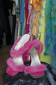 Display of a pair of shoes and clothes in a second hand store, Munich, Upper Bavaria, Bavaria, Germany