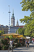 Viktualienmarkt with steeples of St Peter and the New city hall, Munich, Upper Bavaria, Bavaria, Germany