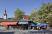 Viktualienmarkt and steeples of the old city hall and Heilig-Geist-church, Munich, Upper Bavaria, Bavaria, Germany