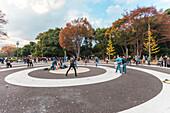 Elvis doubles dancing in front of Yoyogi Park, Shibuya, Tokyo, Japan
