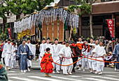 Flower decorated wagon pulled by an ox during Festival Aoi Matsuri in Kyoto, Japan