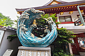 Wave Statue at Kanda-Myojin Shrine in Kanda, Chiyoda-ku, Tokyo, Japan