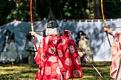 Archer in red costume during Autumn Grand Festival at Meiji Shrine, Shibuya, Tokyo, Japan