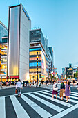Sukiyabashi Crossing with three women in Ginza at blue hour, Chuo-ku, Tokyo, Japan