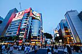 Sukiyabashi Crossing with pedestrians in Ginza at blue hour, Chuo-ku, Tokyo, Japan