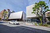 Shopping Street with luxury shops and car in Aoyama, Minato-ku, Tokyo, Japan