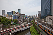 Trains crossing at Ochanomizu Station and canal, Bunkyo-ku, Tokyo, Japan