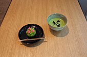 Wagashi sweet shaped like azalea flowers and cold Matcha green tea, Nihonbashi, Chuo-ku, Tokyo, Japan