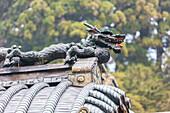 Close-up of dragon shaped sculpture on roof at Toshogu-Shrine, Nikko, Tochigi Prefecture, Japan