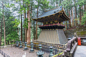Gold decorated buildings and bronze lanterns at Taiyu-in, Nikko, Tochigi Prefecture, Japan