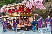 Decorated festival wagon with girls playing music during Yayoi Matsuri in Nikko, Tochigi Prefecture, Japan