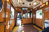 Inside small train Randen towards Arashiyama, Kyoto, Japan