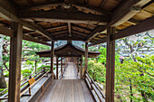 Wooden pathway with roof at temple Ninna-ji, Kyoto, Japan
