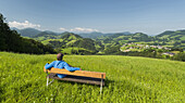 A person on a bench, Upper Austrian Alpine foothills near Maria Neustift, Upper Austria, Austria