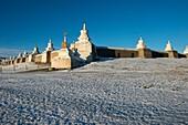 Stupas around Erdene Zuu monastery in Kharakhorum (Karakorum), Mongolia after a snow fall.