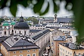 View of the Neustadt district with dome of Dreifaltigkeitskirche Holy Trinity Church, and Priesterhausgasse street, Salzburg, Austria.