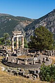 Delphi, Phocis, Greece. The tholos, dating from around 380-360 BC, beside the Sanctuary of Athena Pronaia. Ancient Delphi is a UNESCO World Heritage Site.