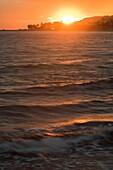 Sunset sea in Villajoyosa Mediterranean sea in background Alicante Spain.