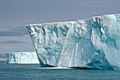 Water Pours From face of Brasvellbreen Glacier on Nordaustlandet. Svalbard Archipelago, Arctic Norway.