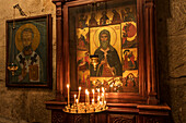 'Lit candles by a Christian Orthodox icon in the interior of Svetitskhoveli Cathedral; Mtskheta, Mtskheta-Mtianeti, Georgia'