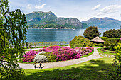 A couple of tourists visit the gardens of Villa Melzi d'Eril in Bellagio, Lake Como, Lombardy, Italy