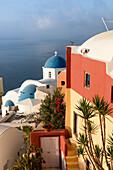 Blue domes of the churches dominate the Aegean Sea Santorini Cyclades Greece Europe