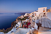 View of the Aegean Sea from the typical greek village of Oia at dusk Santorini Cyclades Greece Europe