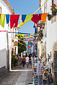 Tourists in the typical alleys of the ancient fortified village of Obidos Oeste Leiria District Portugal Europe