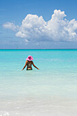 Bather in the turquoise waters of the Caribbean Sea Jolly Beach Antigua and Barbuda Leeward Island West Indies