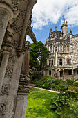 Old mystical buildings of Romanesque Gothic and Renaissance style inside the park Quinta da Regaleira Sintra Portugal Europe